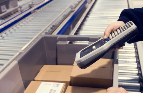 Person scanning label on box