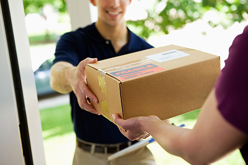 Man Delivering Package to Doorstep